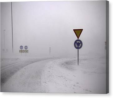 Road Signs In Snowy Landscape Canvas Print by K.Magnusson