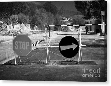 roadblock at greek cypriot border post at famagusta at the UN buffer zone in the green line Canvas Print by Joe Fox