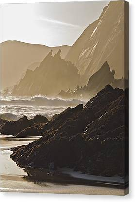 Rock And Waves Dingle Peninsular Canvas Print by Julian Easten