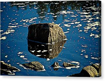 Rock Reflection In Blue Water Canvas Print by Andre Faubert