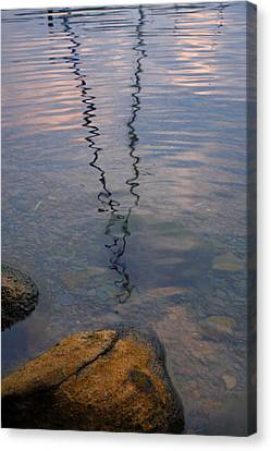 Rocks And Reflection Canvas Print by Steven Ainsworth