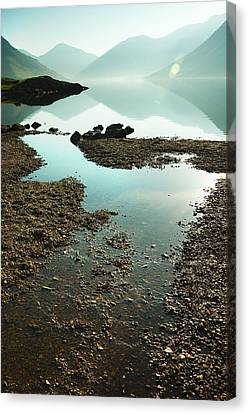 Rocks On The Beach Canvas Print by Svetlana Sewell