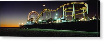 Rollercoaster And Ferris Wheel At Dusk Canvas Print by Axiom Photographic