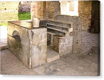 Roman Tavern, Ostia Antica Canvas Print by Sheila Terry