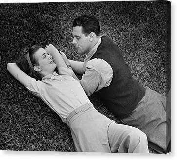Romantic Couple Lying On Grass, (b&w), Elevated View Canvas Print by George Marks