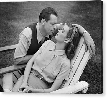 Romantic Couple Relaxing On Deckchair, (b&w) Canvas Print by George Marks