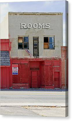 Rooms And A Beer Sign Canvas Print by James Steele