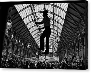 Ropewalker In Covent Garden Canvas Print by Aldo Cervato