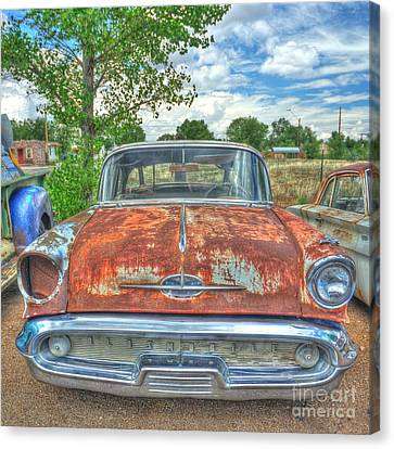 Route 66 Oldsmobile Canvas Print by John Kelly