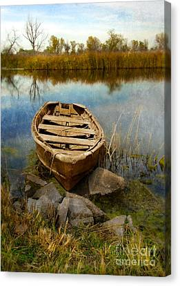 Row Boat At Edge Of River Canvas Print by Jill Battaglia