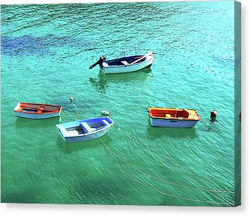 Row Boats On Turquoise Water Canvas Print by Leniners