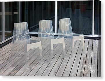 Row Of Modern Translucent Chairs Canvas Print by Jaak Nilson