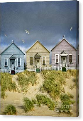 Row Of Pastel Colored Beach Cottages Canvas Print by Jill Battaglia