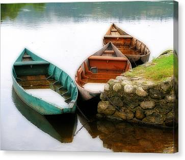 Rowing Boats Out Of Season Canvas Print by Rod Jones