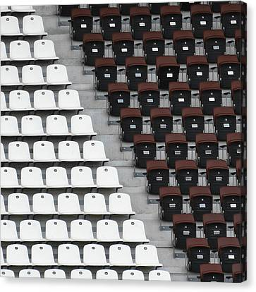 Rows Of Seats In Different Colors Canvas Print by Befo