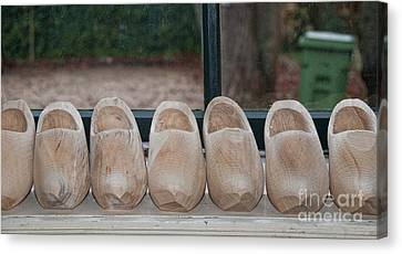Rows Of Wooden Shoes Canvas Print by Carol Ailles