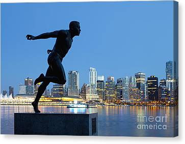 Running Sculpture With A Downtown Background Canvas Print by Bryan Mullennix