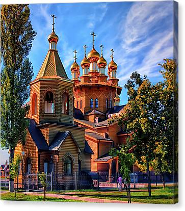 Russian Wooden Church Canvas Print by Gennadiy Golovskoy