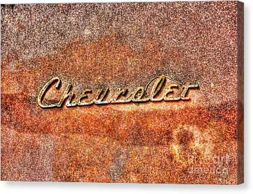 Rusted Antique Chevrolet Logo Canvas Print by Dan Stone