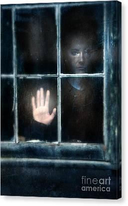 Sad Person Looking Out Window Canvas Print by Jill Battaglia