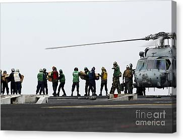 Sailors And Marines Load Supplies Onto Canvas Print by Stocktrek Images
