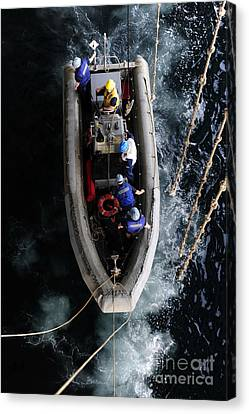 Sailors Conduct A Man Overboard Drill Canvas Print by Stocktrek Images