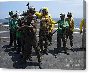 Sailors Fight A Simulated Fire Drill Canvas Print by Stocktrek Images