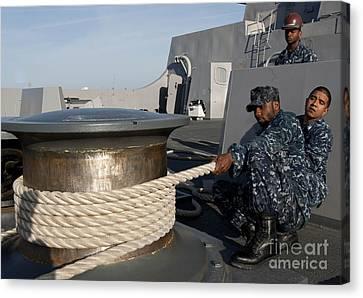 Sailors Handle Mooring Lines Aboard Uss Canvas Print by Stocktrek Images