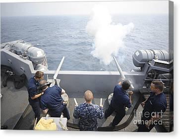 Sailors Perform A 21-gun Salute Aboard Canvas Print by Stocktrek Images