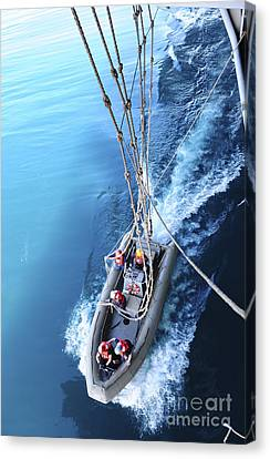 Sailors Release Lines From A Rigid Hull Canvas Print