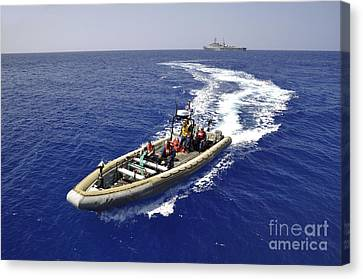 Sailors Transit An Inflatable Boat Canvas Print by Stocktrek Images