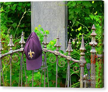 Canvas Print featuring the photograph Saints Hat On Iron Fence by Jeanne  Woods