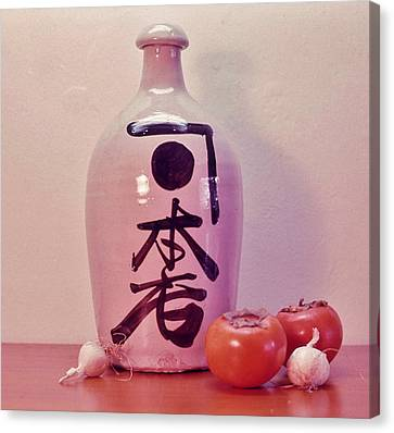 Canvas Print featuring the photograph Sake Jug With Persimmon And Garlic by Craig Wood