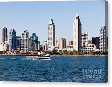 San Diego Skyline And Tour Boat Canvas Print by Paul Velgos