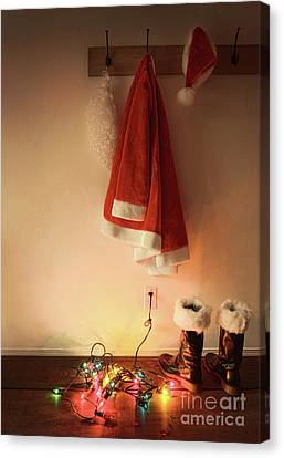 Santa Costume Hanging On Coat Hook With Christmas Lights Canvas Print by Sandra Cunningham