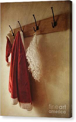 Santa Costume Hanging On Coat Rack Canvas Print by Sandra Cunningham