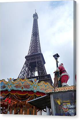 Santa Visits The Eiffel Tower Canvas Print by Amelia Racca