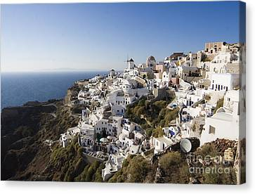Canvas Print featuring the photograph Santorini Cliff by Leslie Leda