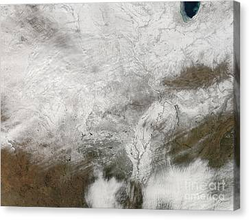 Satellite View Of A Severe Winter Storm Canvas Print by Stocktrek Images