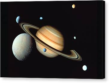 Saturn And Satellites Canvas Print by John Foxx