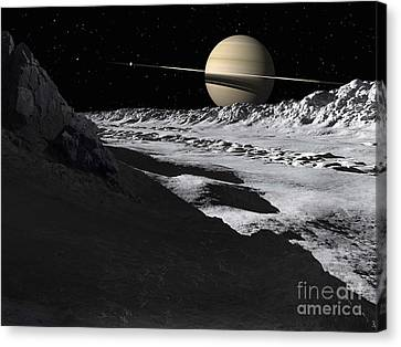 Saturns Moon, Tethys, Is Split By An Canvas Print by Ron Miller