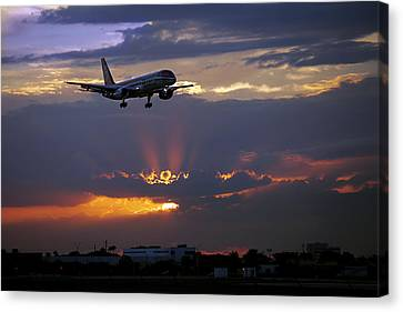 Sba's Aircraft Approaching The Runway At Twilight. Miami. Fl. Us Canvas Print
