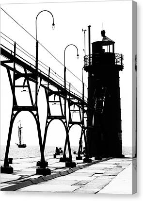 Canvas Print featuring the photograph Schooner And Lighthouse by Coby Cooper