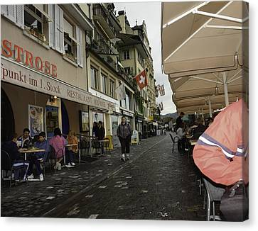 Seated In The Cafe Along The River In Lucerne In Switzerland Canvas Print by Ashish Agarwal