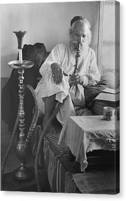 Seated Man Smoking A Nargile, Or Water Canvas Print by Everett