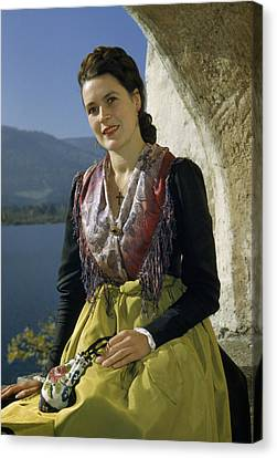 Seated Woman Wears Dirndl Skirt Canvas Print by Volkmar Wentzel