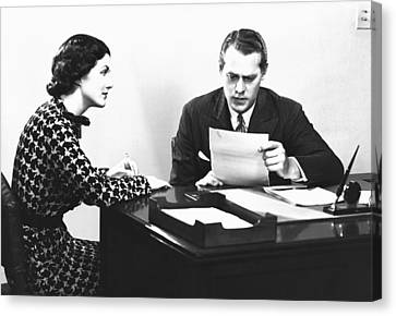 Secretary Assisting Businessman Reading Document At Desk, (b&w) Canvas Print by George Marks