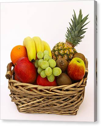 Selection Of Tempting Fresh Fruits In A Basket Canvas Print by Rosemary Calvert