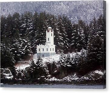 Sentinel Island Lighthouse In The Snow Canvas Print by Myrna Bradshaw