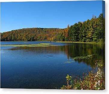 Serene Lake In Fall Canvas Print by Leontine Vandermeer